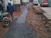 Po opravení ležaté kanalizace byla provedena do vyspádovaného a zhutněného terénu betonáž koryta.